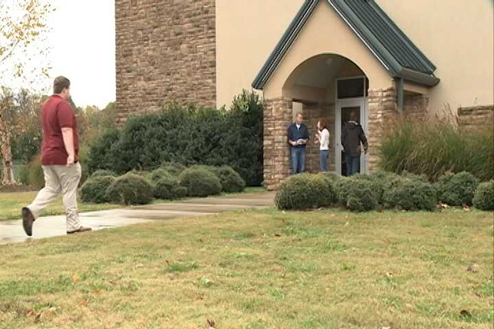 People braving the rain to vote at the Mt. Comfort Church of Christ in Fayetteville Tuesday morning.