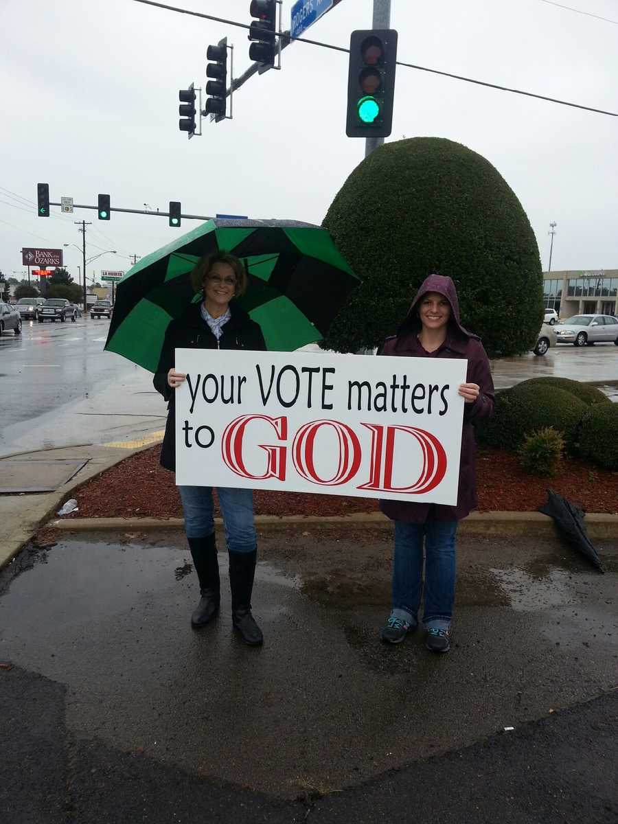 People campaigning at Refuge Ministries at the corner of Rogers Ave and Waldron in Fort Smith Tuesday.