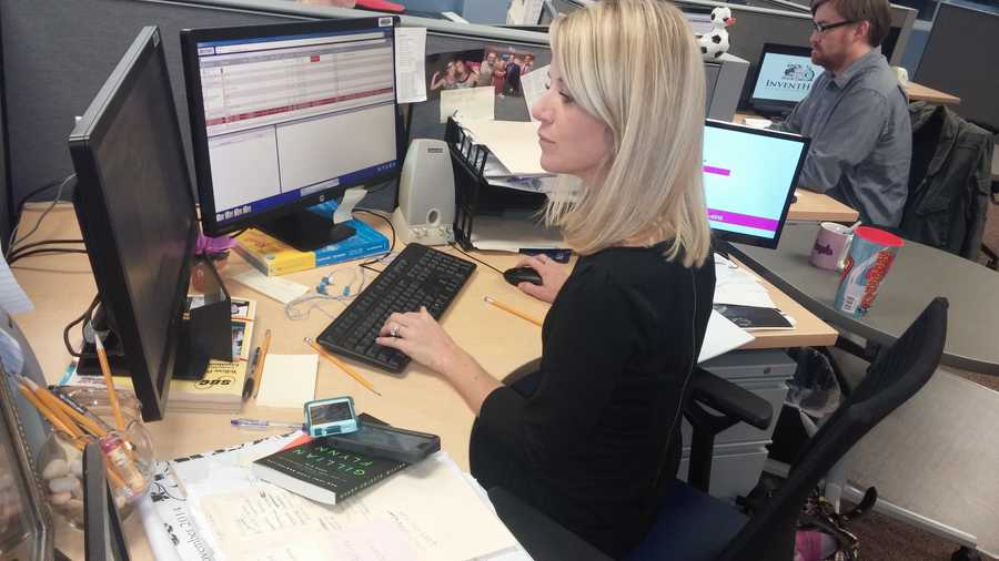 Behind the Scenes: 40/29 Anchor Angela Taylor researching the latest on the races.