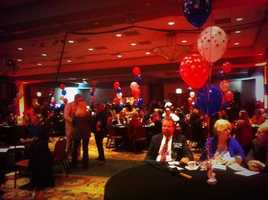 Crowd packing into Embassy Suites ballroom forthe Asa Hutchinsonwatch party.