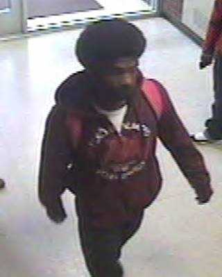 Surveillance still of the suspect in an armed robbery at Pomfret Hall.