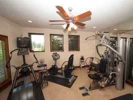 The home also includes an exercise room, a game room, a library/study, a media room and a mud room.
