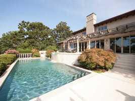 This beautiful Italian Villa inspired home includes a lavish designer pool.