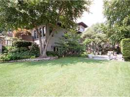The home includes a 2,000-bottle, temperature controlled wine cellar and a secret garden, with access to lush grounds.