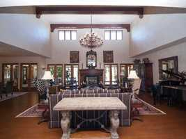 The open floor plan includes a large living room/kitchen/family room.