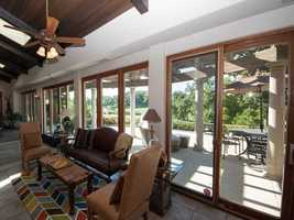 The patio overlooks the large yard.