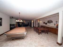 The basement includes plenty of room for entertaining and relaxing.