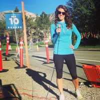 AJ did a lot of emceeing at races before she moved to Arkansas and loved watching runners cross the finish line!