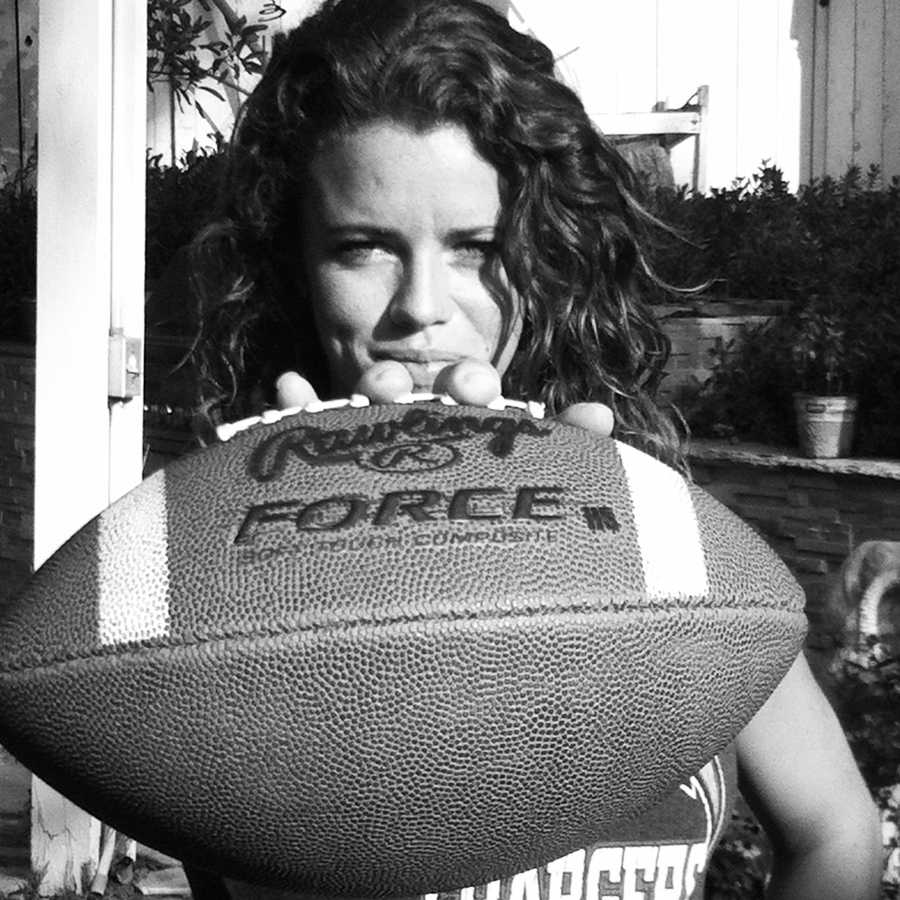 Football is AJ's first love. She grew up a die-hard Chargers fan.