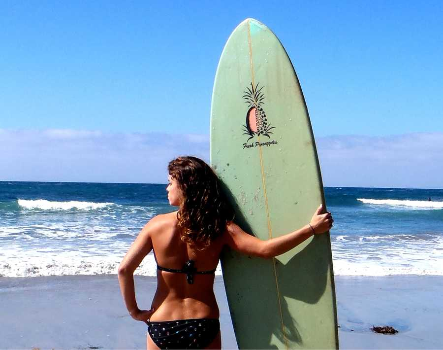 Surfing is AJ's favorite sport. She grew up surfing with her dad.
