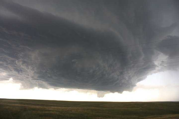 I am also obsessed with severe weather. I began storm chasing in high school and kept venturing further away from home. This picture is a Mesocyclone some friends & I chased in NW Nebraska in 2010. It's this passion that has made me a better severe weather forecaster.
