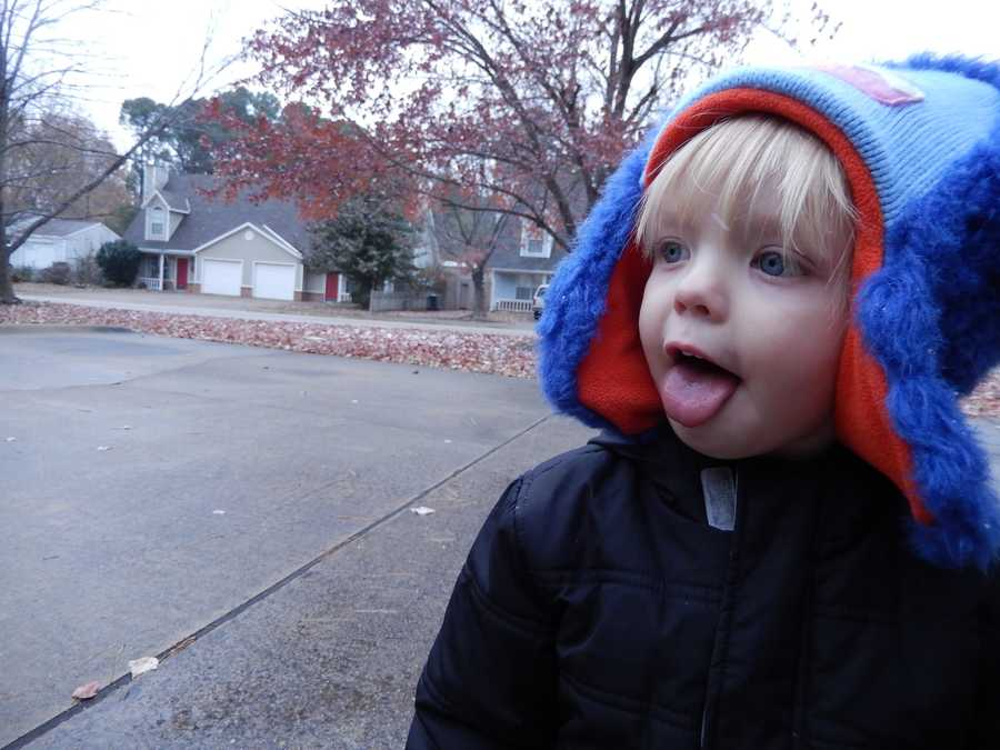 Alexander catching snowflakes in Fayetteville.