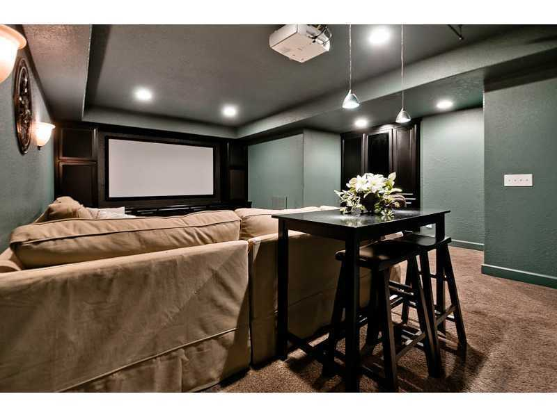 The walkout basement includes a theater room.