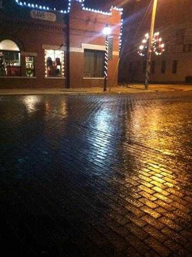 Streets in downtown Rogers were wet at 5:30 a.m.