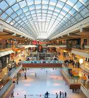 Shop at The Galleria. This is the largest mall in Texas, with over 375 stores. You can see the ice rink and skylight in this photo.