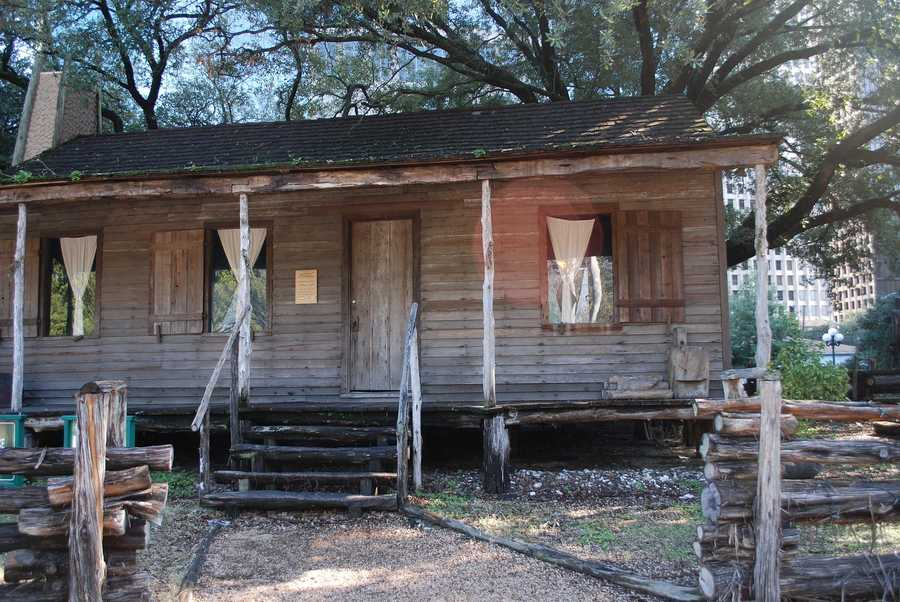 See Sam Houston Park. The park tells the story of Houston's history, and includes a cabin dated to 1823.