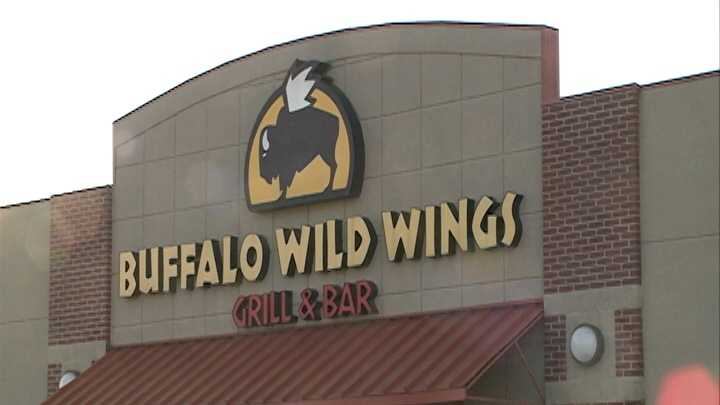 Fayetteville police officers are looking for a suspect in an armed robbery at Buffalo Wild Wings.
