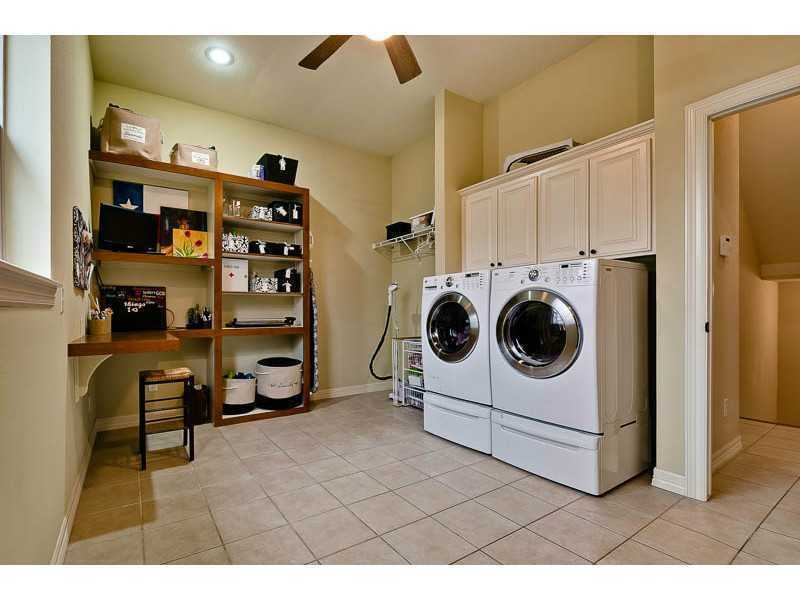 The large laundry room leaves plenty of room for craft space.