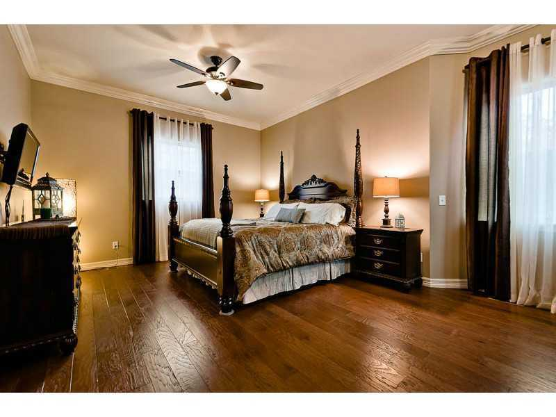 The home includes five bedrooms - one on the main floor, three upstairs and one in the basement.