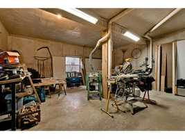 The basement includes a 529 square foot workshop and a 378 poured wall bunker.