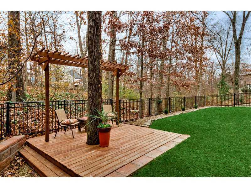 It sites on a 0.83 acre lot, with an iron fence.
