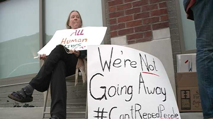 Supporters of the repealed Ordinance 119 gathered on the doorsteps of Fayetteville's Chamber of Commerce.