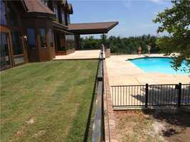 The large patio deck overlooks the pool!
