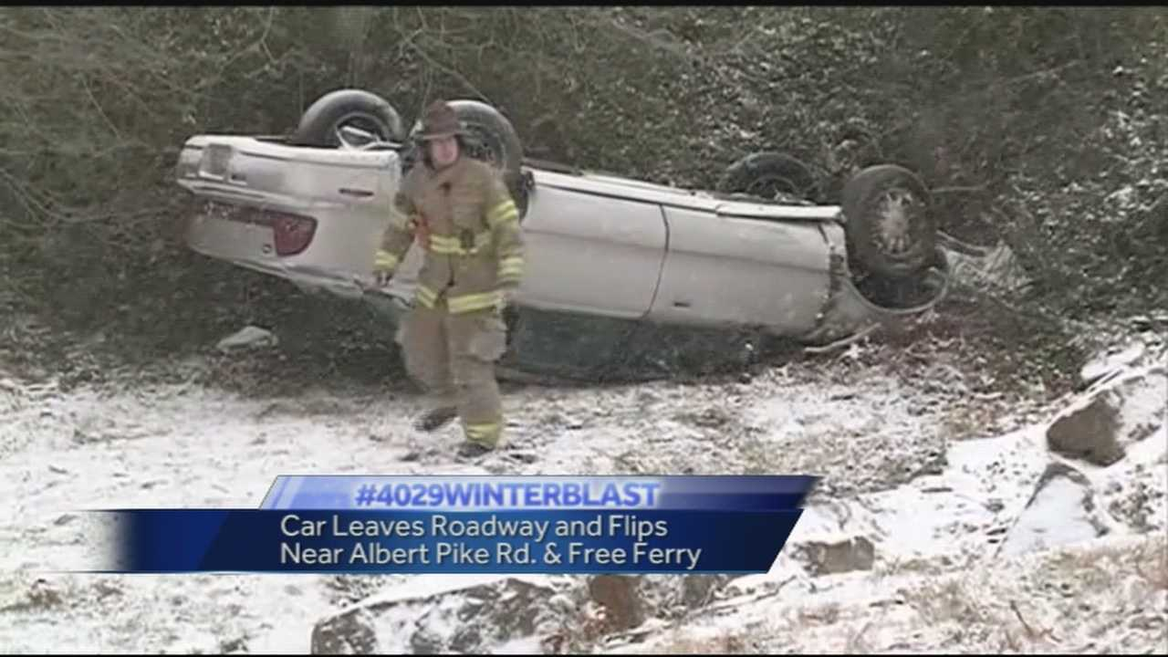 Slick roads caused this car to leave the roadway and flip into a ditch off of Albert Pike in Fort Smith