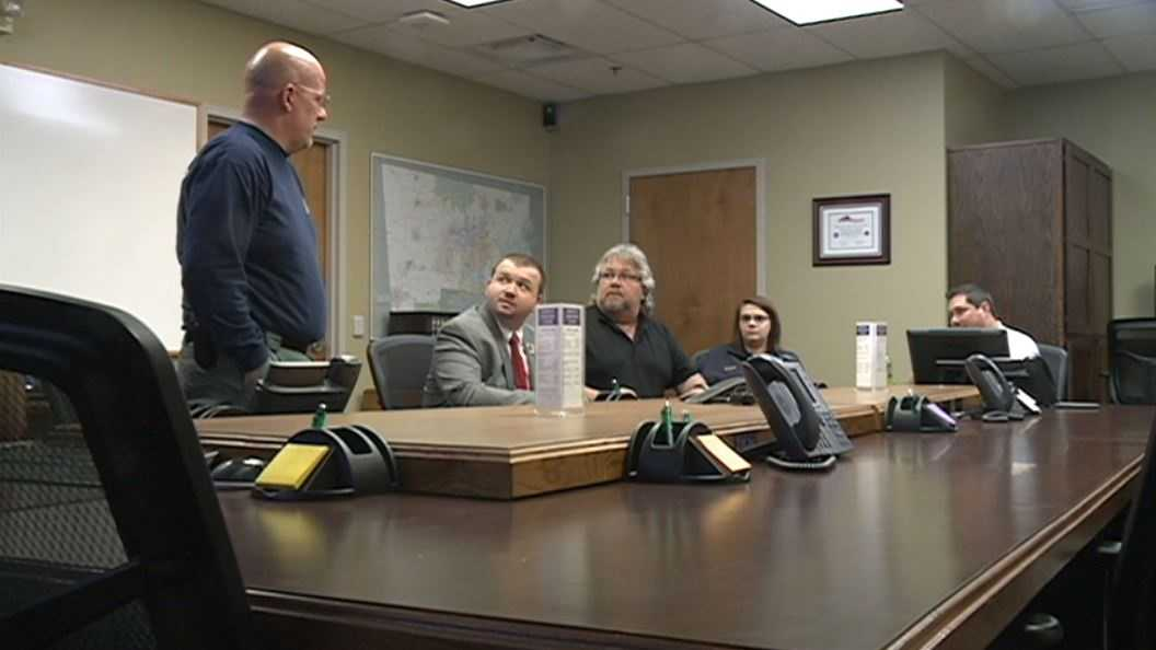 Benton County officials listen in on conference call regarding weather preparedness.