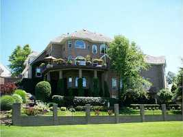 This 7 bedroom, 5 bathroom (with two half baths) is located at 95 W Champions Blvd in Rogers.