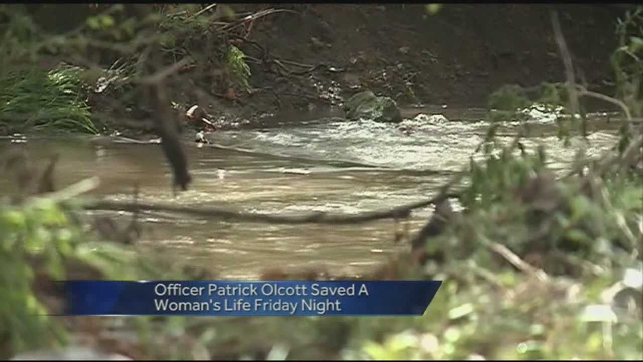 Springdale Police Officer saves woman from flood waters at Puppy Creek raod.