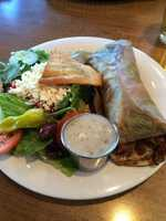 Taziki's Mediterranean Cafe in Bentonville and Fayetteville is the perfect place to go if you are looking to share a delicious gyro with your furry friend! Their patio is open and available for dogs and will give your pooch some water to quench their thirst!