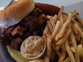 If you are looking for good barbeque in Eureka Springs, Bubba's Barbeque is a great place to go! Be sure to check out their daily specials on their Facebook Page! Pictured here is the rib sandwich with fries and a hot link on the side.