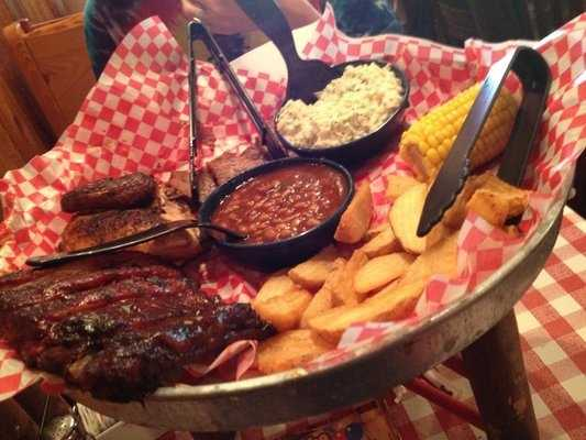 "Famous Dave's is a great place to get BBQ if you are in the Rogers area. Their meat is slow cooked over night and plated to perfection for every order. Most items on their menu are award winning, including their St. Louis style ribs and all of their sauces. Pictured here is one of their famous ""feasts"" which are always enough to feed a family!"