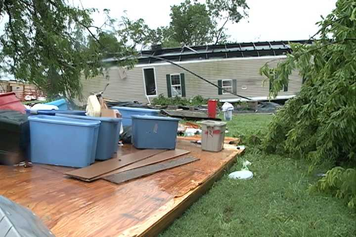 Strong Winds Cause Tree, Trailer To Trap Woman Inside Storm Shelter