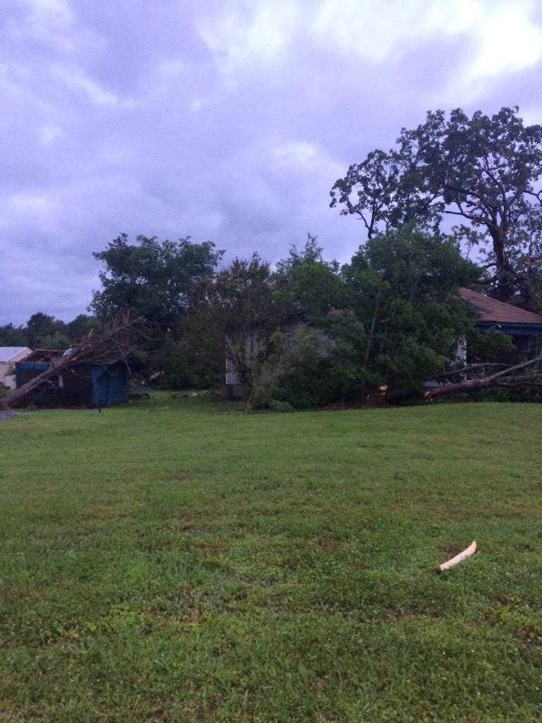 Tree fallen on top of a house in Poteau from major storm damage.