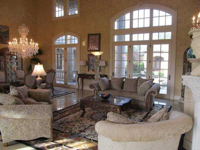 This home was built as a custom Mediterranean Resort Property with a cabana, poll, 4-stall horse barn and media room!