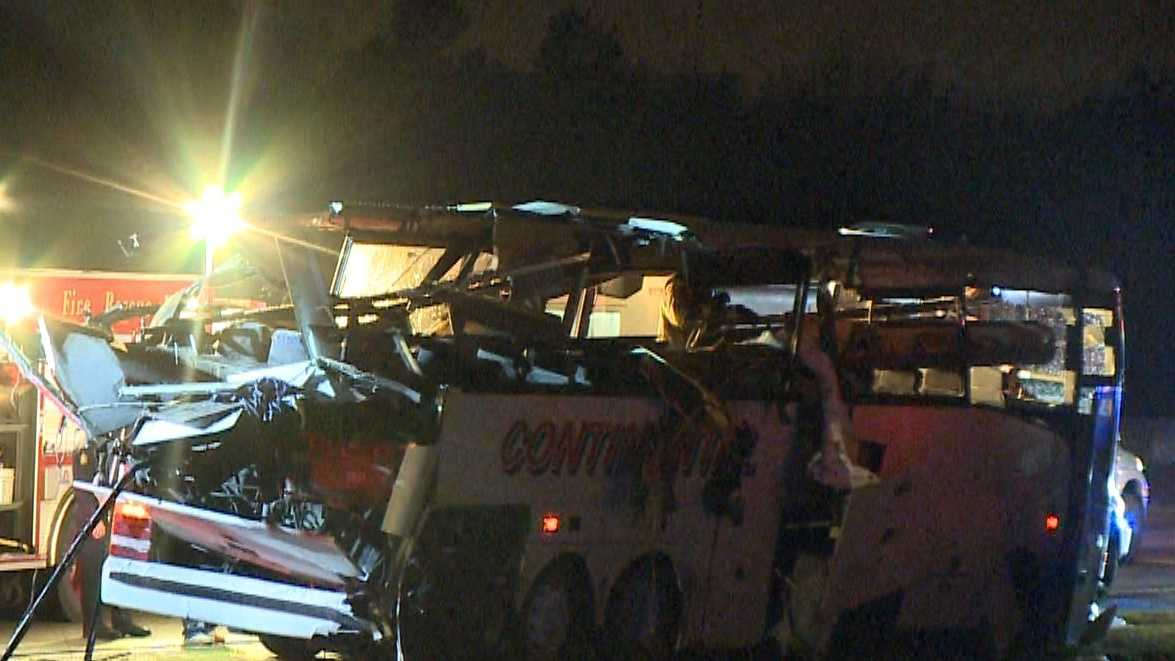Images from the scene showing a damaged charter bus after it ran off Interstate 40 and hit a bridge abutment on Friday, Nov. 6, 2015 in North Little Rock Ark.