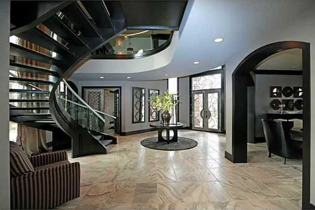 A beautiful and spacious foyer with an incredible grand staircase.