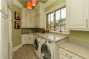 This is a really lovely laundry room/storage space.