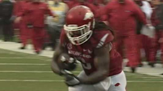 Junior running back Alex Collins runs for three touchdowns in the first half to give Hogs big halftime lead