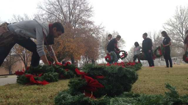 Volunteers prepare the wreaths for Saturday's wreath-laying event.