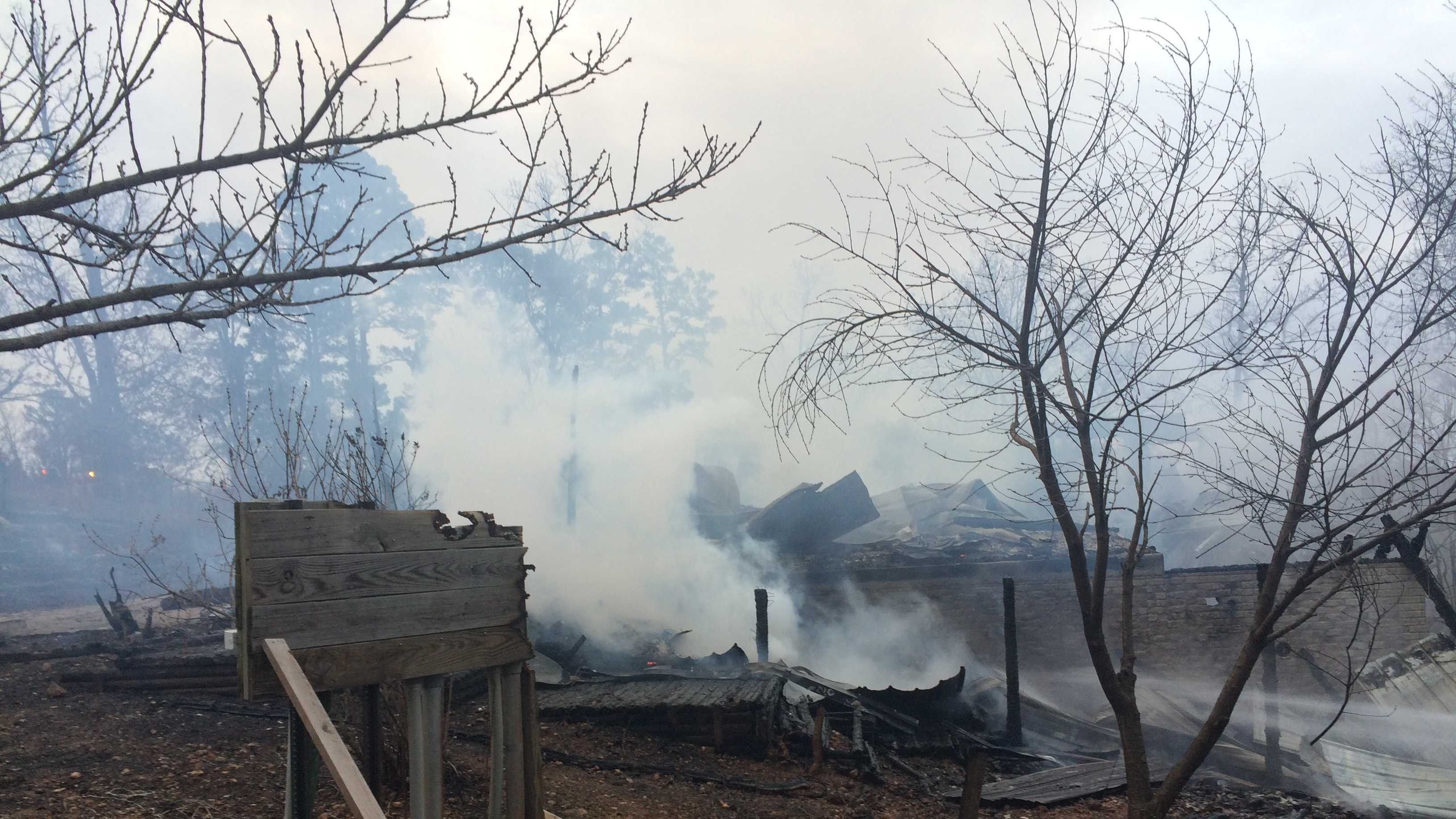 A woman escapes this log cabin after her dog woke her up. (Courtesy: Eureka Springs Fire Department)