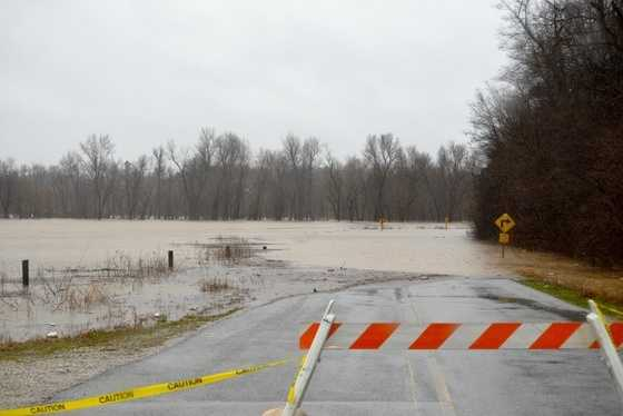 Location: Siloam Springs. The Illinois River is causing flooding on nearby roads, including Highway 16.