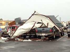 The tornado hit McKee Foods in Gentry causing damage to an outside building and several employee's cars.