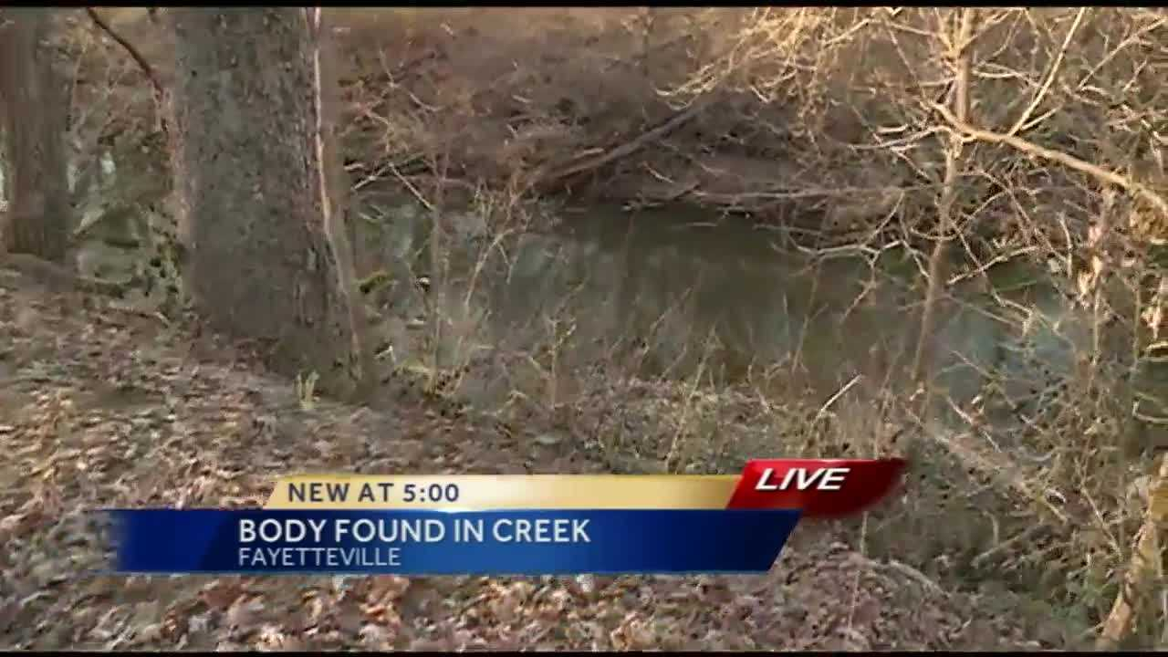 Fayetteville police just left a popular trail where a body was found in a creek.