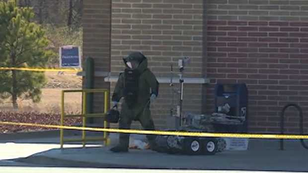 bomb squad person with robot 2