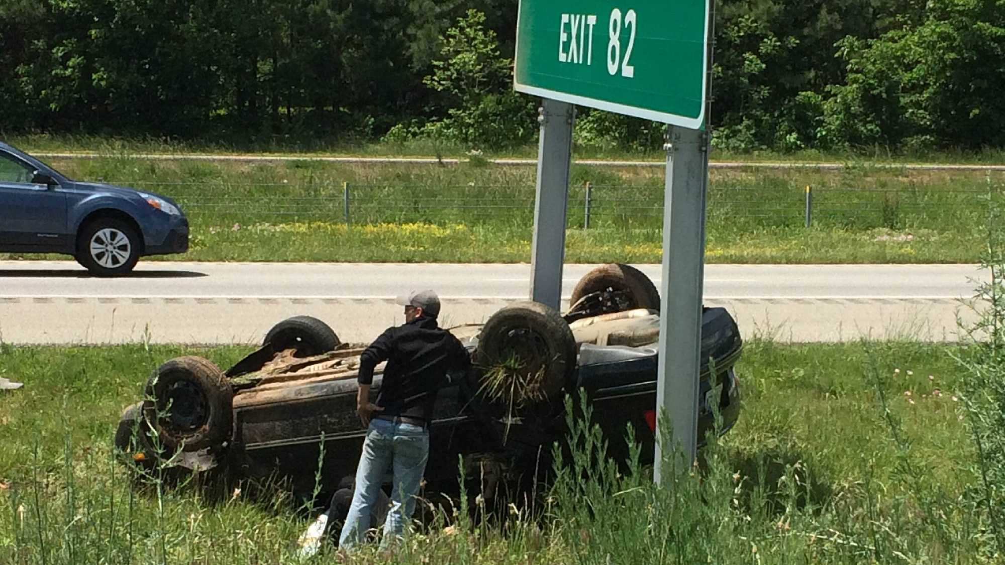 car flips over on i49 rogers