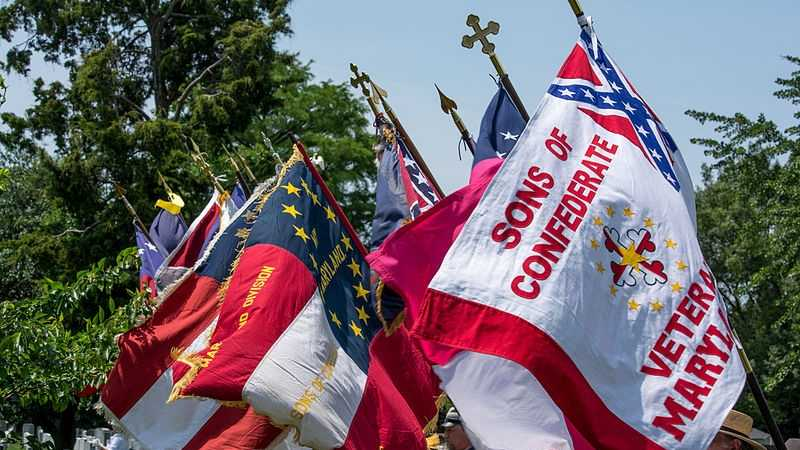 Confederate flags flap in the breeze during Confederate Memorial Day exercises at the Confederate Memorial in Arlington National Cemetery in Arlington County, Virginia, in the United States on June 8, 2014.