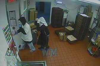 Kansas City police release surveillance images of the Burger King robbery on Blue Parkway Monday morning.